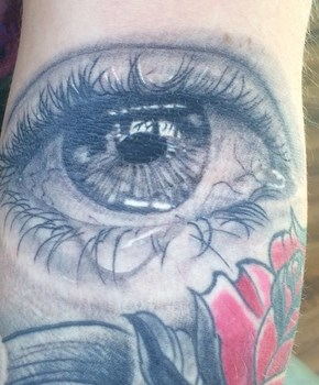 crying eye tattoo